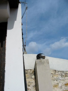 The edge of our upstairs, next door's roof, the next neighbour's roof